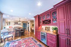 Red wine bar and elegant kitchen - Designer: Gene Abel, Kitchens by Design #rugs #hardwoodfloor www.mykbdhome.com