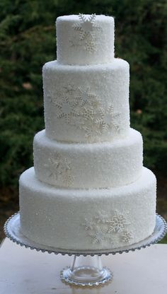 - White fondant with sanding sugar and white snowflakes.