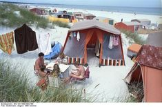 Family camping on the beach at Prerow, Germany, 1990