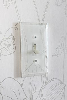 use clear switch plate covers over wallpaper