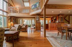 Timber Frame Custom Great Room in the Merrill Brook Barn. Visit to see more on this post and beam house, including floor plans. #postandbeamhomes