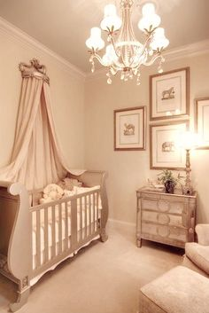 Elegant Baby's Nursery with Mirrored Furniture and Sleigh Crib