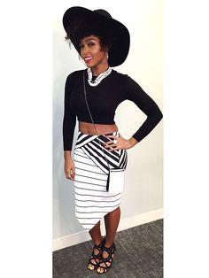 black crop shirt + black and white cross body purse +  black and white stripe asymmetrical skirt + black heels