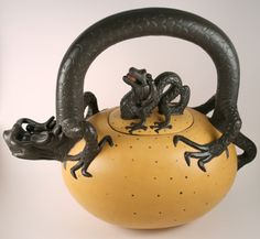 Got one of these at a Police Auction for 25 bucks!!  SCORE!  The mother dragon is protective of her hatching young and will protect your precious tea, as well.  The bright tone of the egg accentuates the detail of the dragons.  The size and splendor make this teapot ideal for gatherings of friends.  (Yi Xing clay is porous and will absorb the flavor of the tea used.) 50.5 oz.