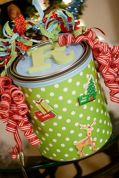 Decorate a paint can to put your kids new Christmas PJ's in.  Take a picture of them every year in their new PJ's and store in the can so they can look back at themselves each year.