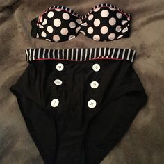 Brand New high waisted bikini Brand new. Never worn. This swimsuit is absolutely adorable. Strapless top with polka dots and stripes. Navy. Buttons up bottoms. So adorable! ❤️ Swim Bikinis