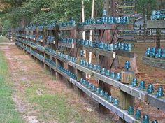 green glass insulators on fences