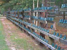green glass insulators on fences