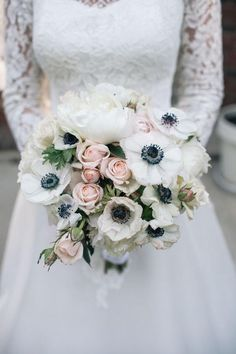 Photographer: Nine Zero Three Photography | Floral Design: Creations by Lynn via Project Wedding; The perfect bouquet to go with a long sleeve lace dress.