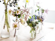 For longer stems, use taller, dainty bottles; shorter vessels work well with bigger, stockier blooms. Play around creating asymmetrical arrangements.
