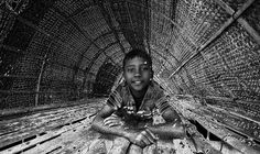 https://flic.kr/p/PtvxN8 | photon ! | the kid of photons ..looks to dark .....! while he was  resting inside the shade of their fishing boat on the bank of dying river padma of munshigonj district , bangladesh Copyright :Abdul Malek Babul FBPS . Cell:( +880) 01715298747 & 01837805350 E mail : babul.photopassion@gmail.com bimboo.babul@yahoo.com www.flickr.com/photos/55321771@N08