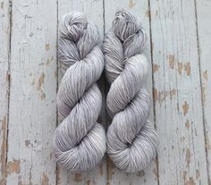 Hand dyed sock yarn. This yarn is dyed in a semi solid light gray. This color is beautiful on its own or paired with a bright variegated, another semi solid, or other neutral colors.  This yarn is a repeatable colorway but due to the nature of hand dyed yarn may vary slightly from what is pictured. Looking for more than what is listed? Send me a convo!  Colorway - Ash  Staple Sock Base - Sock/fingering weight 100 grams/3.5 oz 460 yards 75% Superwash Merino wool/25% Nylon The y...