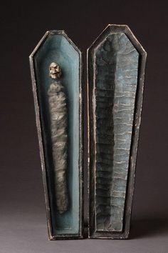 A memento mori of a carved wooden coffin. Austrian, 1761.
