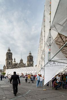 MMX uses scaffolding and canvas to build a cluster of origami-like pavilions in Mexico City.