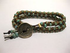 Wrap bracelet with brown waxed cotton cord, antique brass jump rings, turquoise size 6 seed beads, and a leaf design brass button clasp.