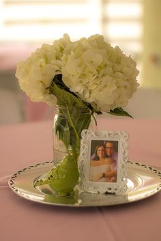 Simple Mason Jar & Hydrangea Centerpieces - could be cute with the picture ideas we're working on.