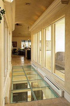 glass flooring Glass floors and bridges are inspired ways to move light (and create a cool view) between floors. See how by clicking through. Basement Flooring, Basement Remodeling, Floor Design, House Design, Walking On Glass, Glass Bridge, Townhouse Garden, Glass Floor, House Windows