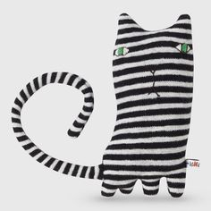 Mono Cat loves mint humbugs, and likes crossing Zebra Crossings.100% lambswool with polyester stuffing.Knitted in Scotland, made by hand.Dimensions 24cmColour B