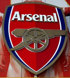 Photo about Arsenal Football Club Cannon Shield, Emirates Stadium, London. Image of symbol, arsenal, gunners - 13677089 Arsenal Football Shirt, Football Shirts, Arsenal Fc, College Basketball, Soccer, Golf Stores, Old Trafford, European Football, Volkswagen Logo