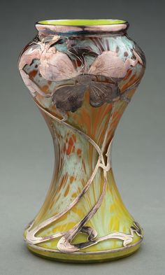 "Loetz vase spreading colors of yellow, brown and Titania-like silver, further decorated with Art Nouveau silver overlay of flowing leaves, stems and flowers. Vase unsigned, silver marked ""Sterling"" near foot. Item Dimensions: x 3 - Belle Epoque, Decoration, Art Decor, Broken Glass Art, Art Nouveau Furniture, Pots, Bohemian Art, Stained Glass Art, Art Deco Design"