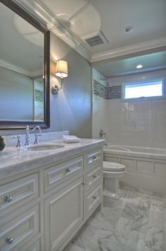 """grey walls, white field tile with """"liner"""" effect (only I would do this a bit lower), carerra marble tops"""