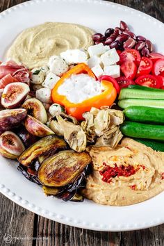 Ready to ditch those boring party platters? Try mezze! Learn how to build the perfect Mediterranean party platter w/ hummus, veggies, olives, cheese & more!