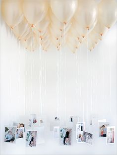 Tying photos of family and friends to balloons makes for a fun photo display | Brides.com