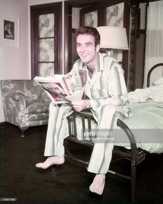 News Photo : American actor Montgomery Clift sitting on the...