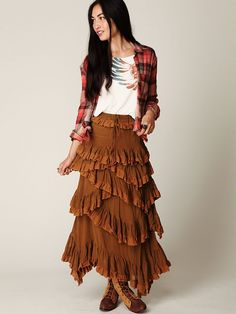 This skirt shows rhythm by radiation because it starts at the top of the skirt and smothly flows downward. Your eye follows.
