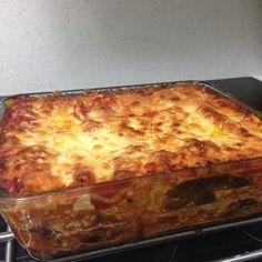 Spinach Ricotta Lasagne, minus the pasta, sub for zucchini!