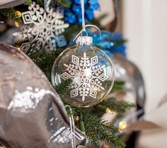 Create gorgeous ornaments by applying intricately cut vinyl snowflakes to the front of glass baubles. You'll be surprised how easy this project is and what a huge impact it makes to your holiday decor! This project cuts images for two different ornament designs.   Make it Now: https://us.cricut.com/design/?utm_content=buffer1586d&utm_medium=social&utm_source=pinterest.com&utm_campaign=buffer#/landing/project-detail/9653