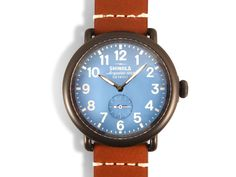 Shinola Runwell 41MM Watch, Fashioned in Stainless Steel with Black Plating, Featuring a Light Blue Dial, Tan Leather Strap and Quartz Movement