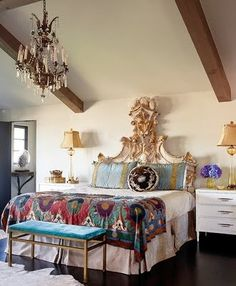The headboard is a bit much, but love the room and the quilt!