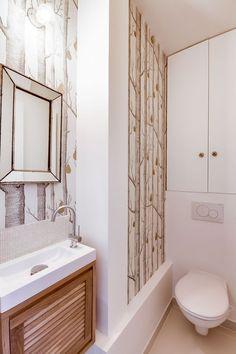Les toilettes ont été revisitées dans un camaïeu blanc et crème