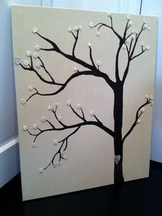 Paint a canvas (I'm thinking leaf green or a sky with clouds), paint the tree and hotglue on the buttns or anything else you can come up with