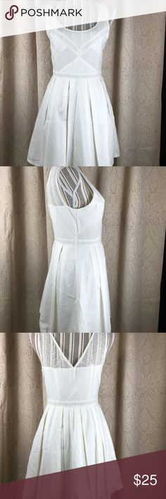 "American Eagle Dress. White with lace. Size 6. American Eagle Dress. White with lace. Size 6. Measurements laying flat: shoulders 13 3/4"", pits 16 1/2"", length 33"",  waist 14"" Like New  #379 American Eagle Outfitters Dresses Mini"