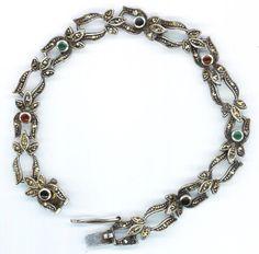 Sterling Silver Vintage Bracelet Marked 925 . Green, Garnet, Black Stones . Marcasite Jewelry - Romantic Whispers by enchantedbeas on Etsy. $49.00, via Etsy.