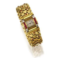 18 KARAT GOLD, PLATINUM, RUBY AND DIAMOND WRISTWATCH, CARTIER, CIRCA 1940 The rectangular domed dial with baton markers, flanked by calibré-cut rubies, and square-cut diamonds weighing approximately .60 carat, completed by gold link bracelet studded with cabochon rubies, manual movement