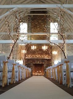 Stunning wedding venue made with tree decorations; fairy lights and fireplace focal point using wood and stones - the natural effect!