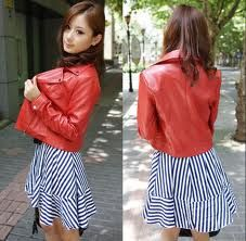 Red bike jacket over a striped dress
