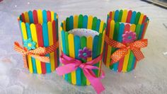 Popsicle stick pencil holders-things used:tin container, cardstock paper as a liner, popsicle sticks, ribbon, foam stickers and tacky glue.