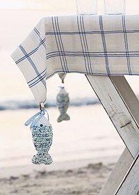 Sew pretty weights on edges to hold down tablecloth