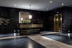"""Reception Desk in Lobby:  nice dimension and texture.  Like the color transition in the tile to """"show"""" the way around"""