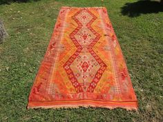 6x13 ft. vintage Turkish kilim rug from Sivas province of Central Anatolia with red and orange color tones  Wool on wool  There are 3 ripped parts on the kilim, please check last 2 photos on the kilim rug  163,3x70,8 inches = 415x180 cm