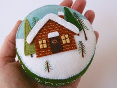 wool felt pincushion with a little log cabin in by FabricAndInk