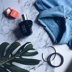 Flat-lay - Monthly Favourites (January)  Denim shirt Lip balm Diesel perfume, cologne Bracelet and cuff Men's fashion, style, trends