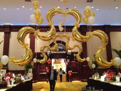 golden arches of balloons Balloon Arch, Balloons, Father Daughter Dance, Event Decor, Gatsby, Event Planning, Entrance, Chandelier, Ceiling Lights