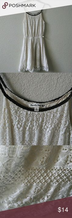 White Lace Dress with Faux Braided Leather Straps Off-white, almost cream colored lacey dress with dark brown braided faux leather straps. Only worn once and is missing the belt. No yellowing, still in like new condition. Double Zero Dresses