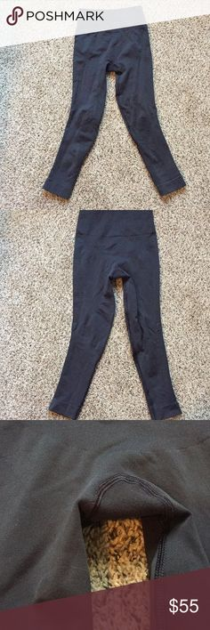 """Crop Lululemon """"zone in tights"""" in charcoal gray These are in good used condition, no holes or stains, just worn, they are a charcoal gray, these could be a 4/6, they have a compression feel to them. two photos aren't mine just to show fit. lululemon athletica Pants Capris"""