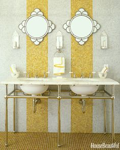 "Designer Jay Jeffers used ""an abundance of glass tiles"" from Waterworks in the guest bathroom of a Sonoma house, covering the entire floor and the wall behind a pair of Waterworks sinks."